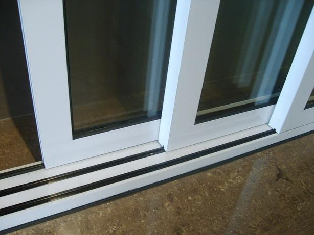Fall homeowner tip 5 ask art builder blog for Exterior multi track sliding doors